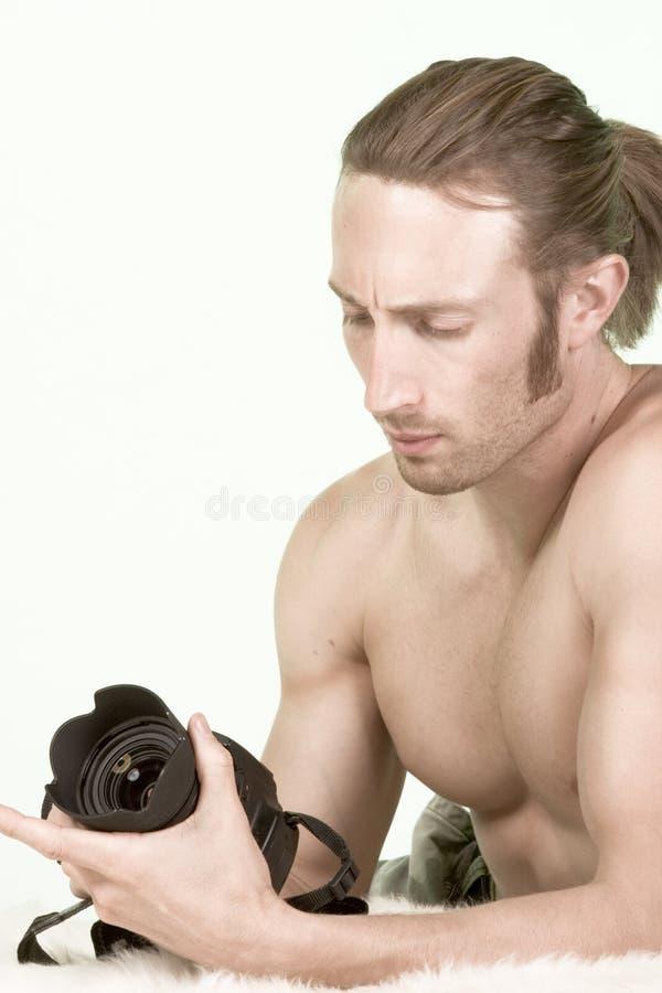 编译照相机检查人肌肉摄影师 免版税库存照片