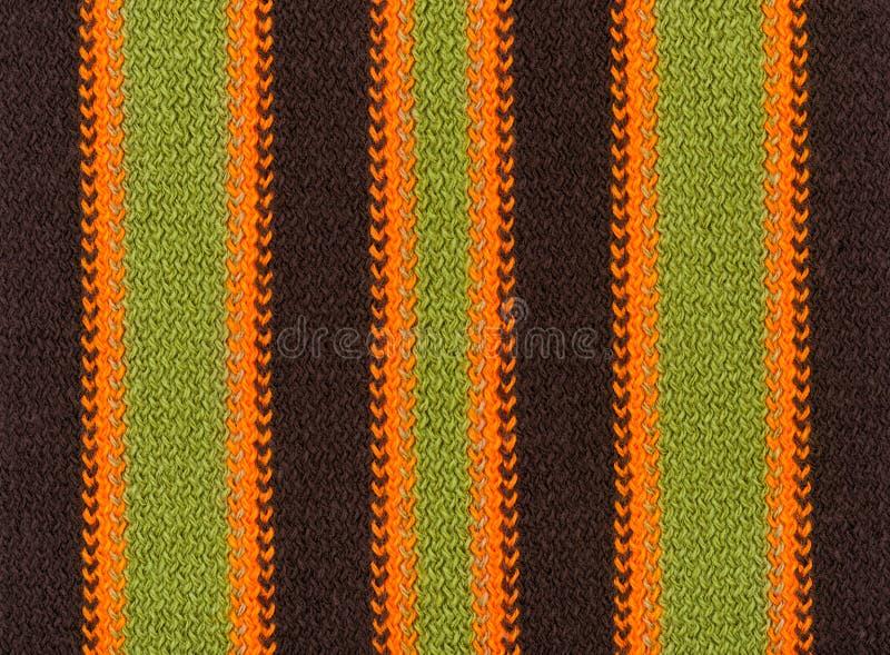 编织羊毛纹理背景,五颜六色和有条纹 免版税库存图片