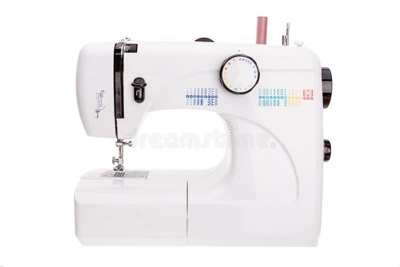 缝合的纺织品的现代缝纫机 库存照片
