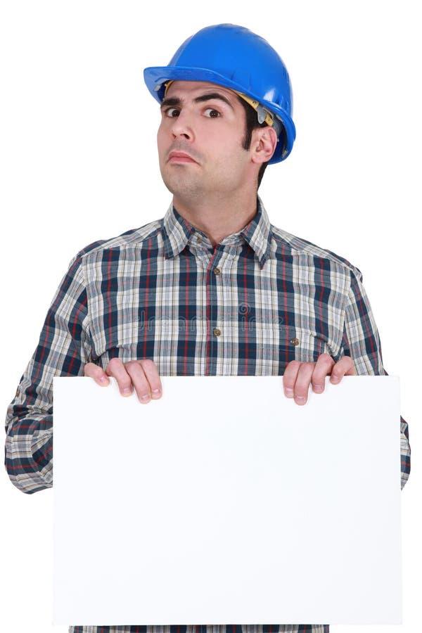 缺乏信心的建筑工人 免版税库存图片