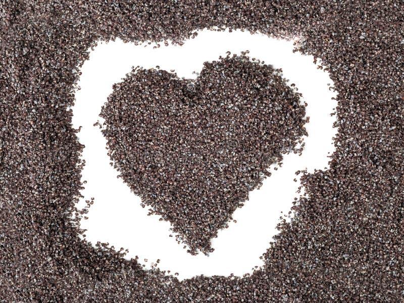 罂粟种子形成的心脏形状 图库摄影