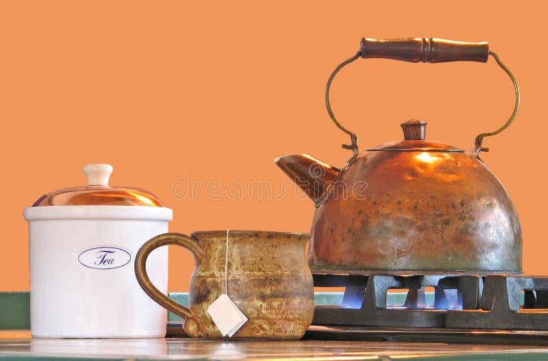 罐铜水壶杯子茶 库存照片
