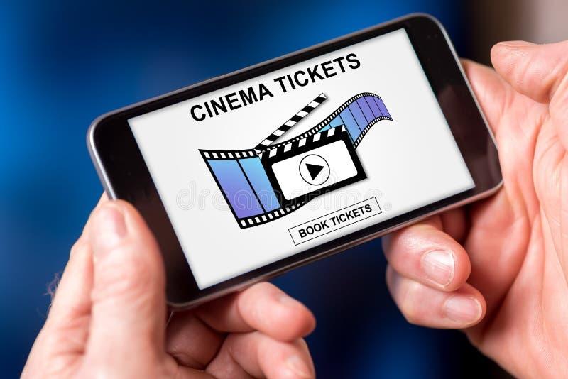 网上戏院卖票在智能手机的售票概念 免版税库存图片