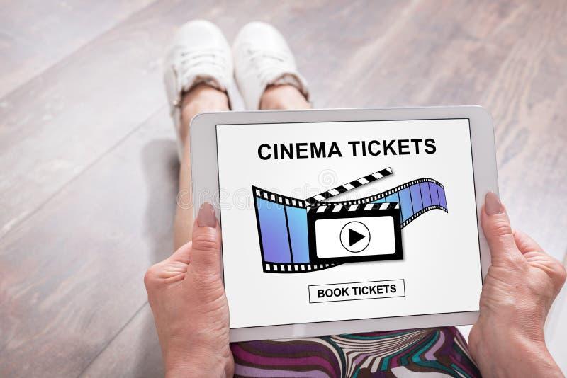 网上戏院卖票在片剂的售票概念 免版税库存照片