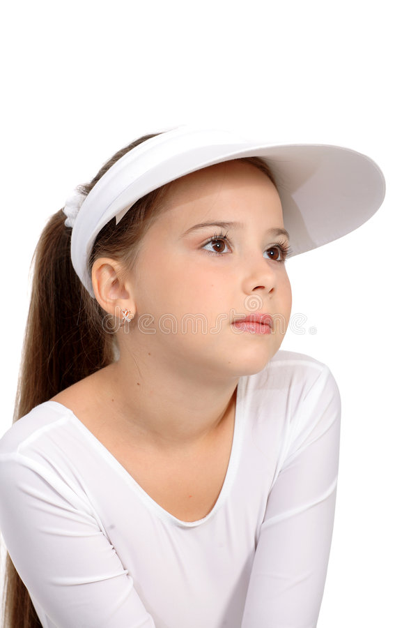 网球顶层和帽子的女孩 库存图片