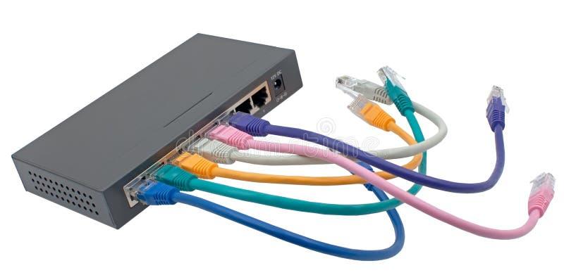 网络缆绳特写镜头被连接到路由器 免版税库存图片