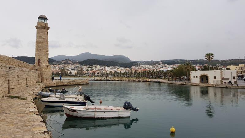 罗希姆诺镇威尼斯式港口灯塔克利特希腊 库存照片