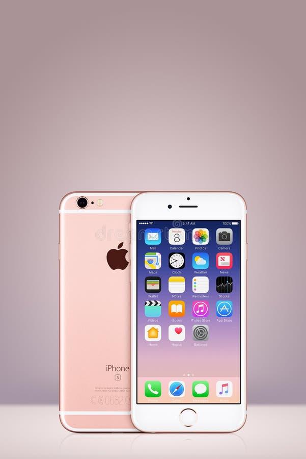 罗斯金与iOS 10的苹果计算机iPhone 7在垂直的梯度背景的屏幕上与拷贝空间 图库摄影