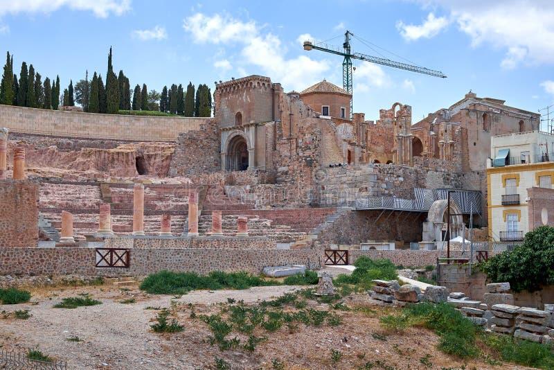 罗马圆形剧场和废墟在卡塔赫钠市,穆尔西亚,西班牙的区域 库存照片