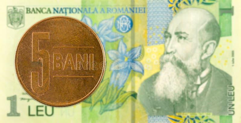 5罗马尼亚人反对1张罗马尼亚列伊钞票的bani硬币 库存图片