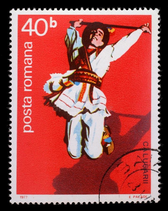 罗马尼亚打印的邮票,展示罗马尼亚男性民间舞蹈 免版税图库摄影