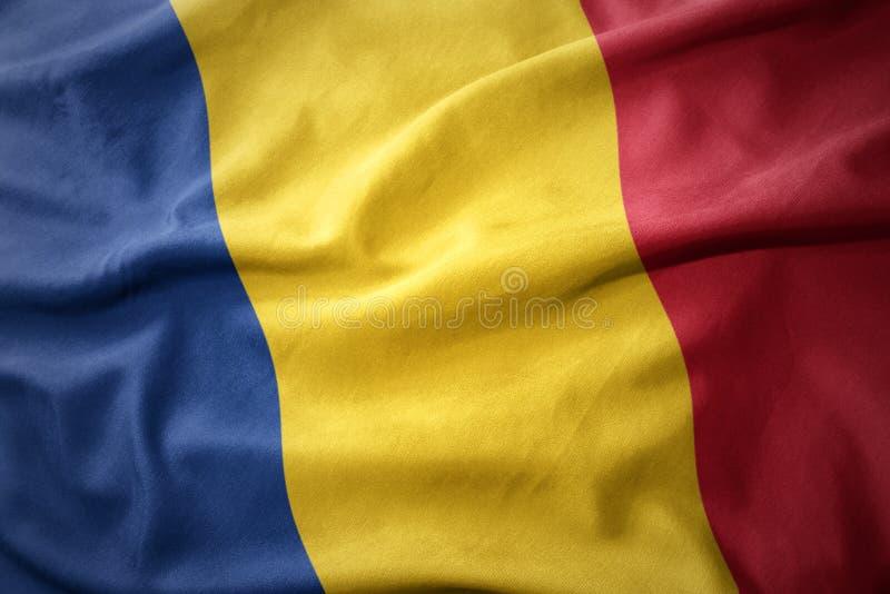 罗马尼亚的挥动的五颜六色的旗子 免版税库存图片