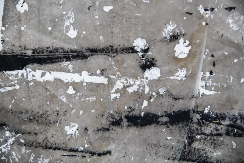 罩布有白色和黑油漆难看的东西背景 免版税库存图片