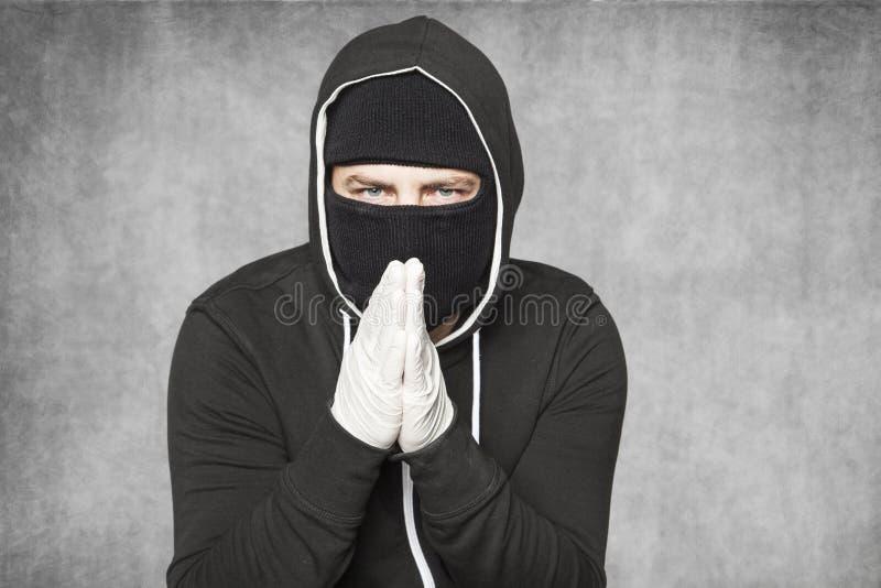 罪犯弄脏他的手想到训练 图库摄影