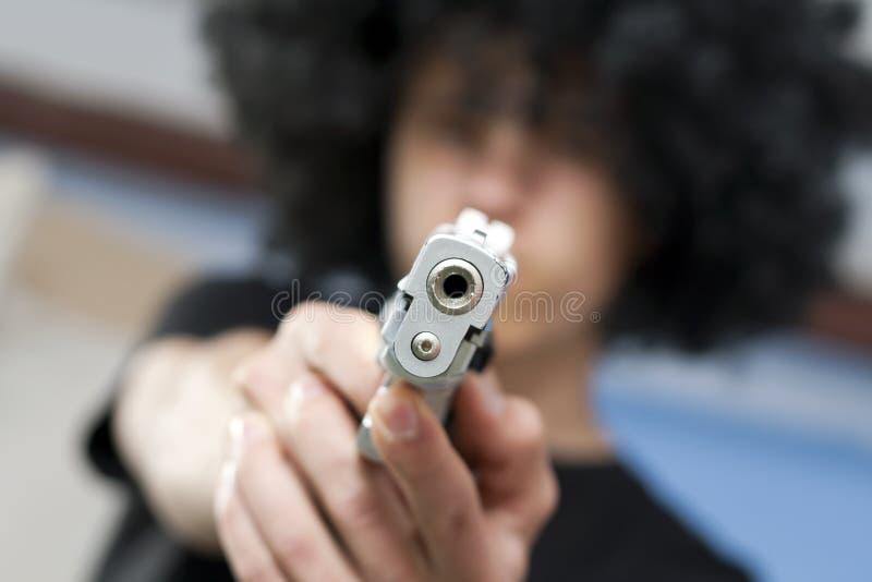 罪行枪年轻人 库存照片