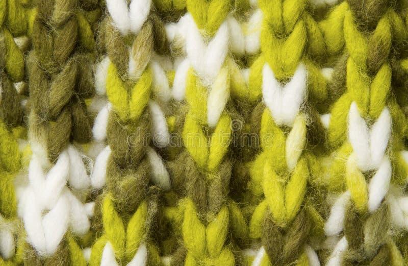 羊毛纹理背景,被编织的羊毛织品,绿色长毛的fluf 免版税库存照片
