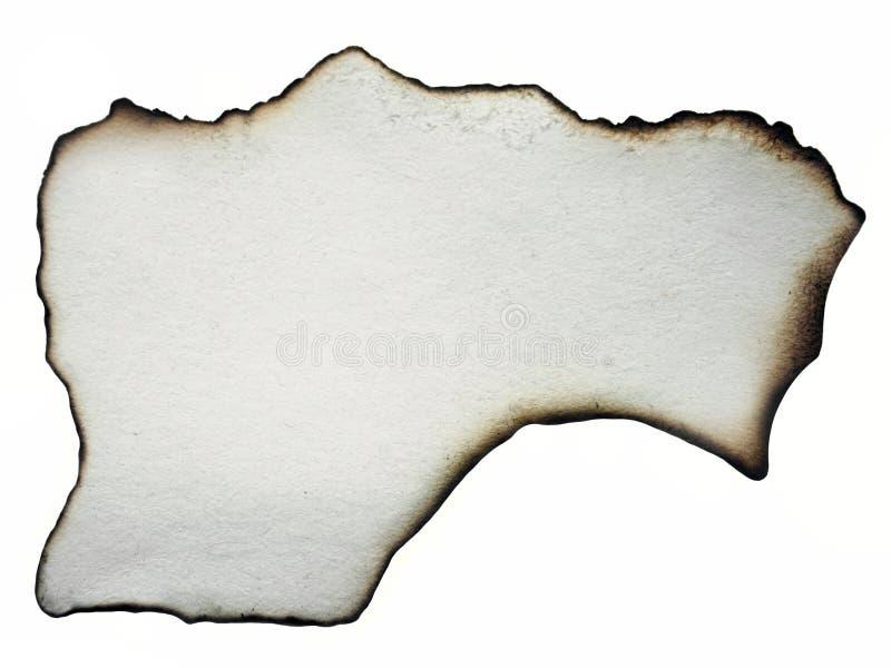 羊皮纸 白色减速火箭在蜡烛烧了一张纸的边缘 免版税库存照片