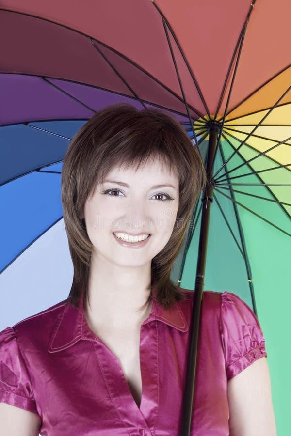 美丽的五颜六色的伞妇女 免版税库存图片