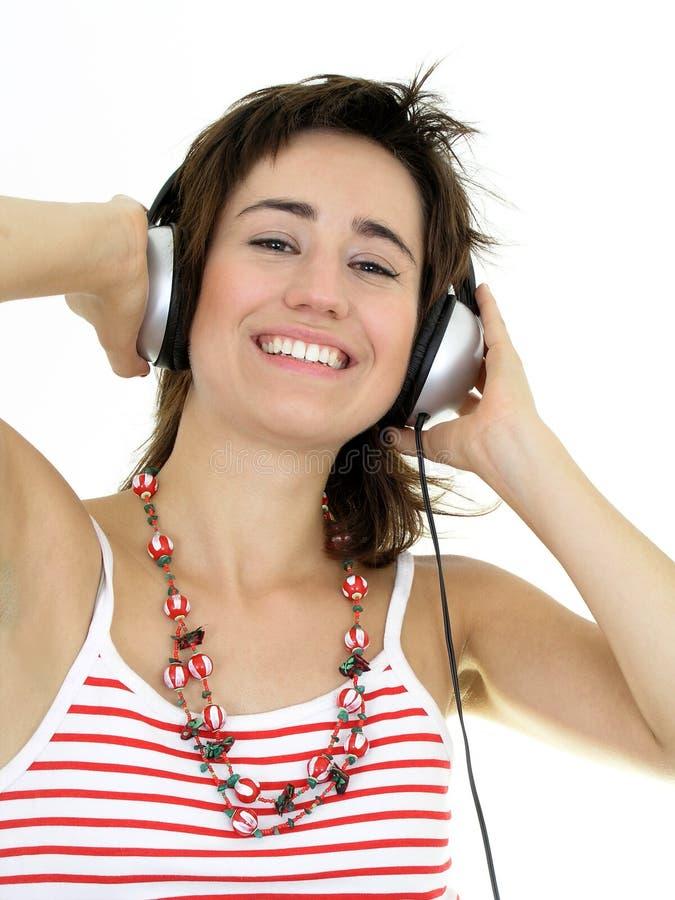 美丽的享用的音乐妇女 免版税库存图片