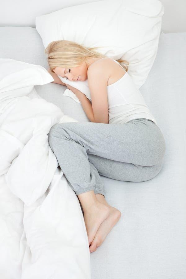 美丽的休眠妇女年轻人 库存图片
