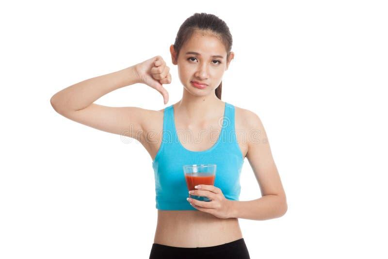 美丽的健康亚洲女孩怨恨西红柿汁翻阅下来 库存图片