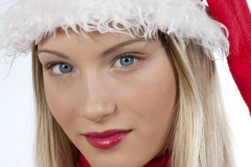美丽的克劳斯女孩圣诞老人 免版税库存照片