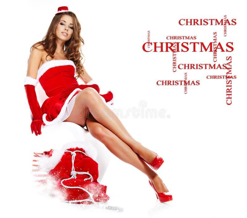 美丽的克劳斯给女孩圣诞老人佩带穿&# 免版税库存照片