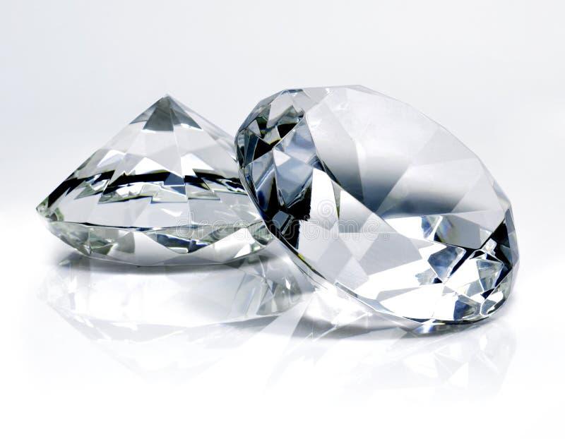 美丽的发光的金刚石,在白色背景 库存照片