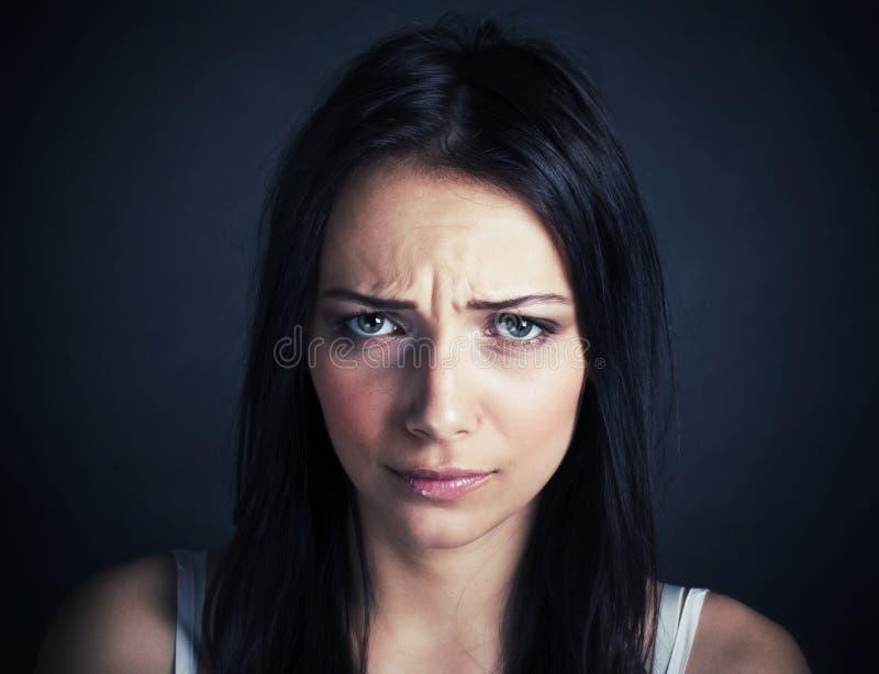 美丽的哀伤的妇女 免版税图库摄影