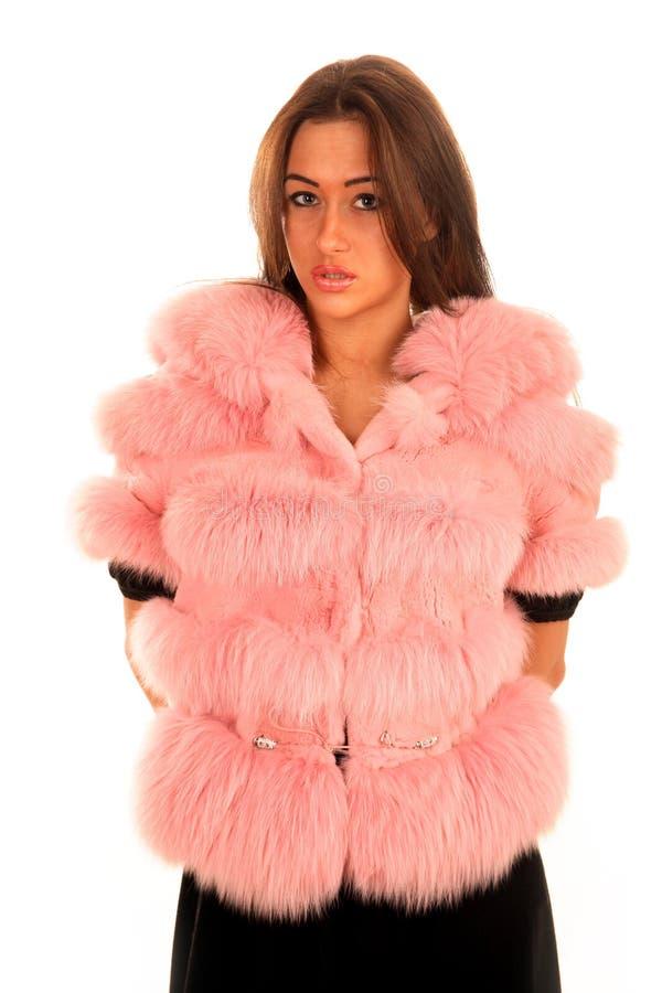 美丽的外套毛皮粉红色妇女年轻人 库存照片