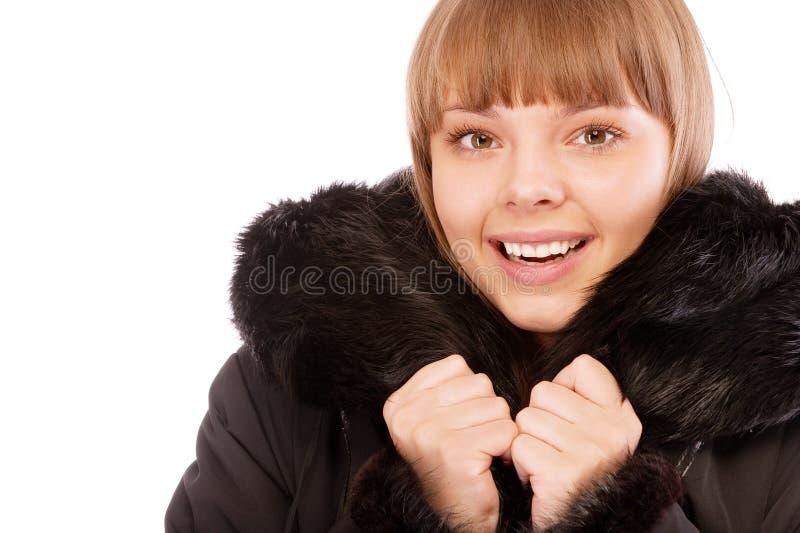 美丽的外套毛皮纵向佩带的妇女 免版税库存照片