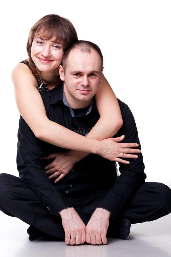 美丽的夫妇愉快的纵向微笑的年轻人 免版税库存图片