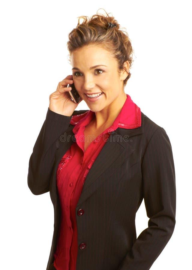 美丽的女商人谈话在手机 库存图片