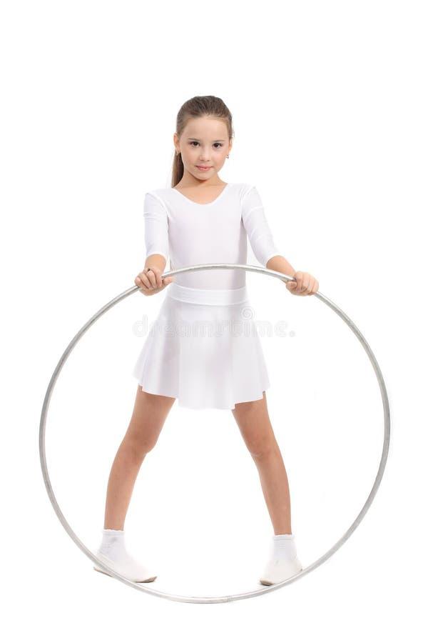 美丽的女孩体操小 免版税库存图片
