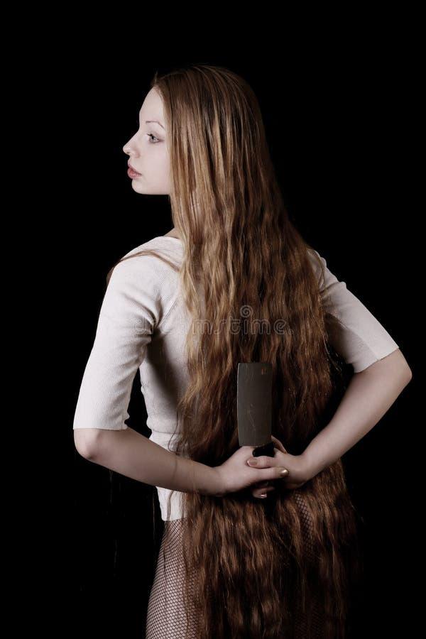 美丽的女孩刀子 库存照片