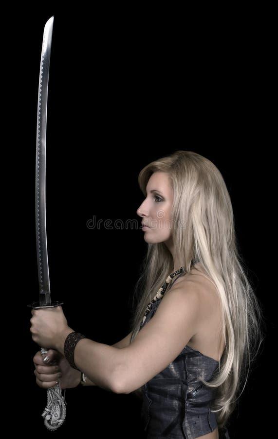 美丽的女孩剑 免版税库存图片
