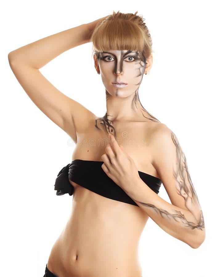 美丽的女孩她的油漆皮肤 免版税库存照片