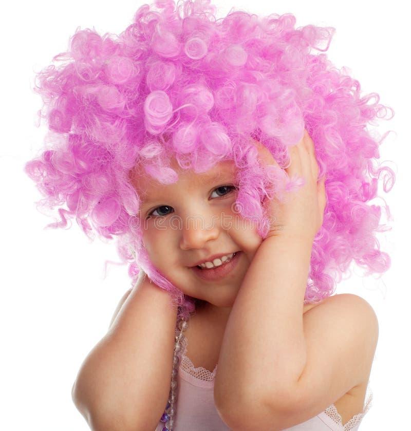 美丽的女孩少许桃红色假发 库存照片