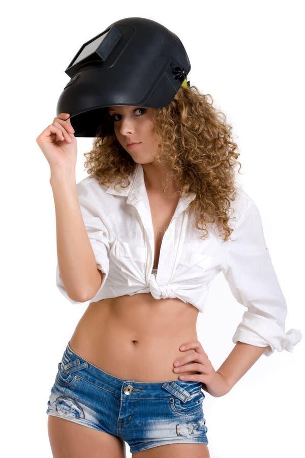 美丽的女孩屏蔽焊工 免版税图库摄影