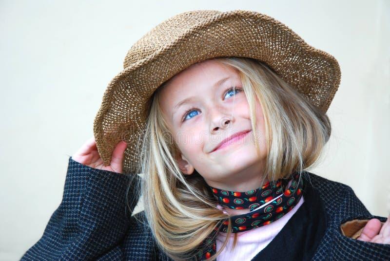 美丽的女孩帽子一点 库存照片
