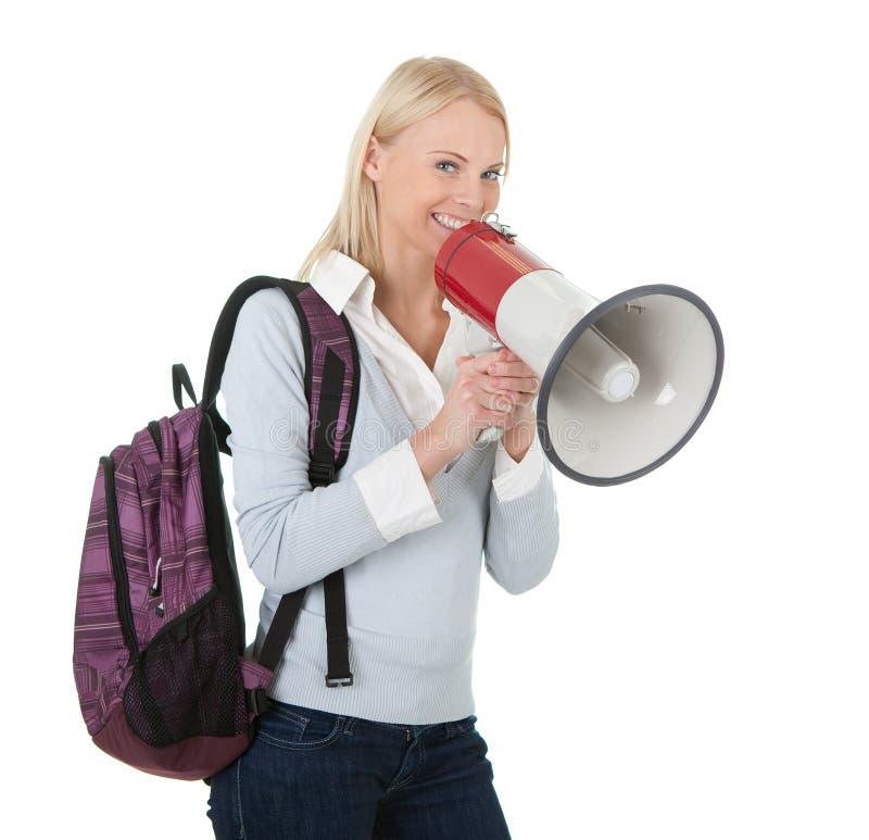 美丽的女孩扩音机呼喊的学员 免版税图库摄影