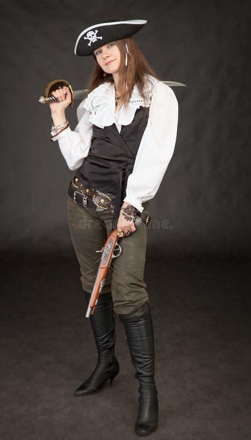 美丽的女孩海盗手枪军刀 库存图片