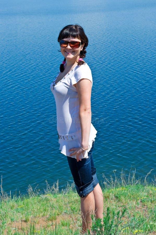 美丽的女孩玻璃星期日 库存图片