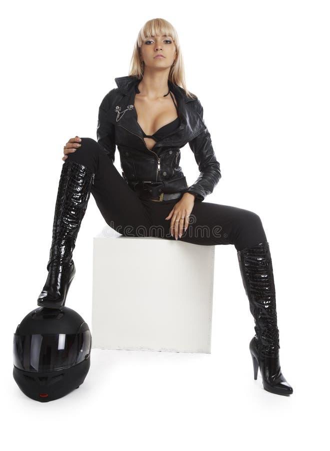 美丽的女孩盔甲摩托车 免版税库存图片