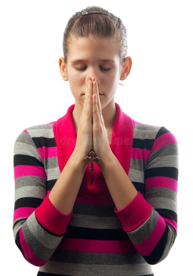 美丽的女孩祈祷的年轻人 免版税图库摄影