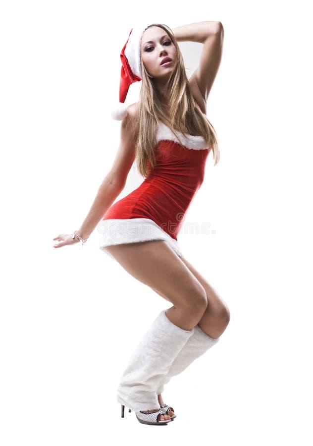 美丽的女孩纵向圣诞老人性感squating 免版税图库摄影