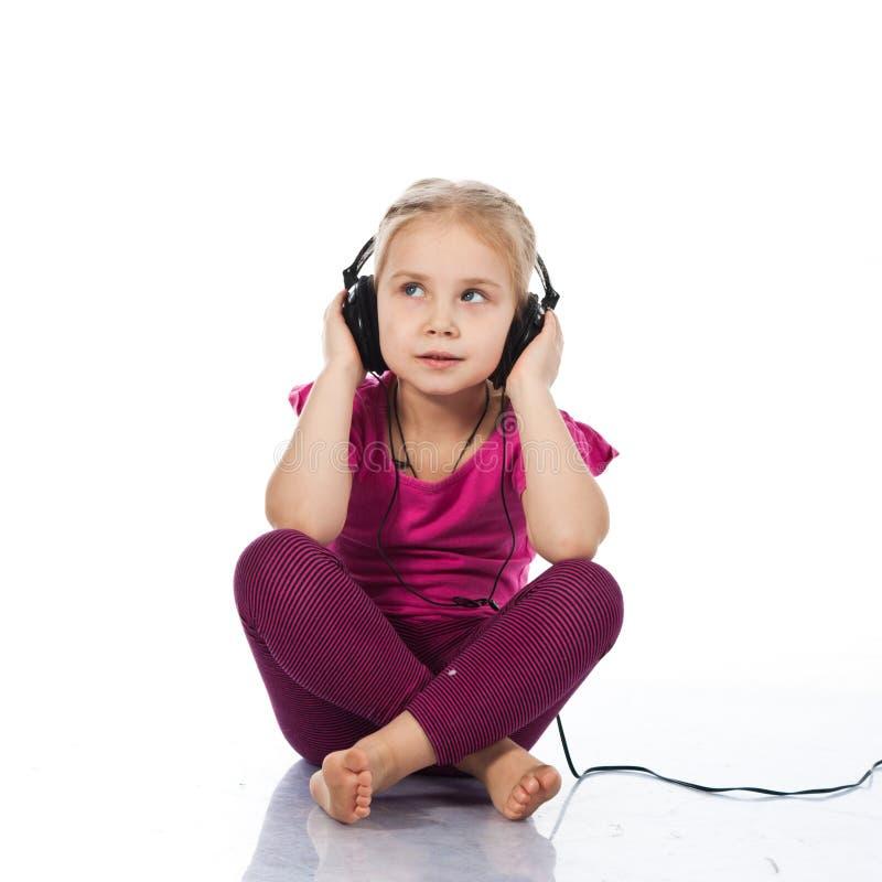美丽的女孩耳机 库存照片