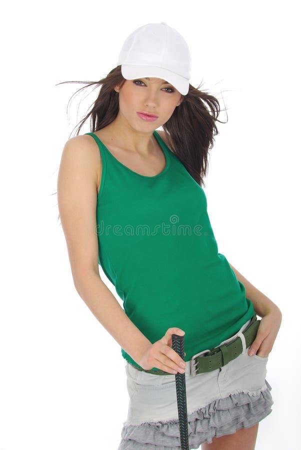 美丽的女孩高尔夫球运动员 免版税库存图片