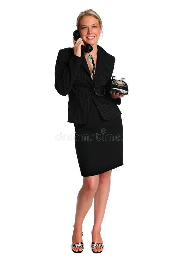 美丽的女实业家电话减速火箭使用 免版税库存照片