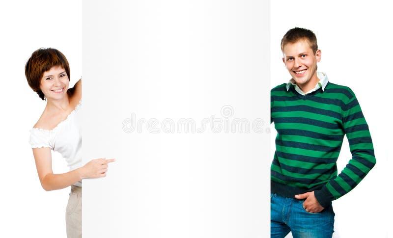 美丽的妇女和人有白板的 库存图片